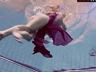 Smoking sexy russian redhead all round a catch pool