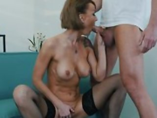 Short haired lady slides hard pecker into the brush trimmed pussy