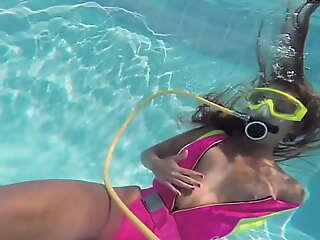 Cute teen Irina Poplavok swims naked below-ground