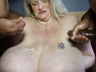 Granny gets cum on her tits